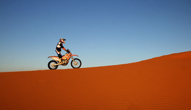 Riding the dunes on a motorcycle is one of the best things to do in Morocco, the Sahara desert (Merzouga)