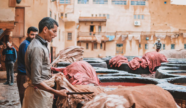 In the Morocco tannery, tanners meticulously remove any remaining meat or hair that may be attached